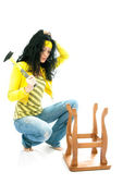 Puzzled woman repairs a chair — Stock Photo