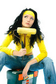 Beautiful woman repairing the house — Stock Photo