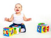 Bebê com brinquedos — Fotografia Stock