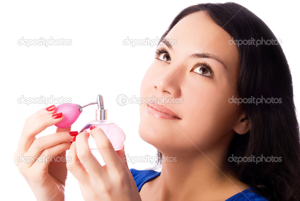 Beautiful young brunette woman smelling perfume isolated against white background — Stock Photo #1994910
