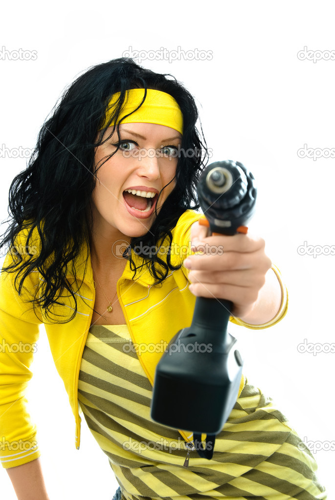 Beautiful young excited woman holding a drill in her hand isolated against white background — Stock Photo #1996206