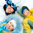 Family on the snow — Stock Photo
