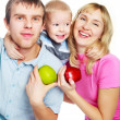 Stock Photo: Family eating apples
