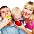 Family eating apples — Stock Photo