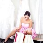 Girl choosing a wedding dress — Stock Photo