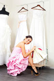 Girl choosing a wedding dress — 图库照片