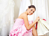 Girl choosing a wedding dress — Stockfoto