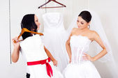 Girl choosing a wedding dress — Photo
