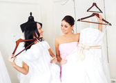 Girl choosing a wedding dress — Stok fotoğraf