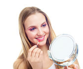 Woman applying lip gloss — Stock Photo