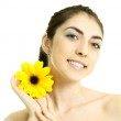Pretty girl with a flower — Stock Photo