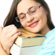 Dreamy student with books — Foto de Stock