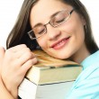 Dreamy student with books — Stockfoto