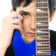 Young man with a guitar — Stock Photo