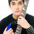 Young man embracing his guitar — Stock Photo