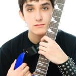 Young man embracing his guitar — Stock Photo