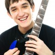 Stock Photo: Laughing young mwith guitar