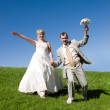 Bride and groom on the hill — Stock Photo