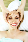 Woman getting a face massage — Stock Photo