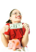 Woman putting money into her piggy bank — Stock Photo