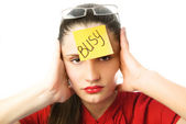"""Tired businesswoman with a note """"busy"""" on her fo — Foto de Stock"""
