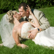 Stock Photo: Bride and groom in the park