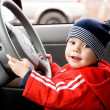Stock Photo: Little boy driving car