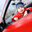 Cute little boy in the car — Stock Photo