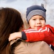 Little boy in his mother's arms — Stock Photo