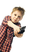 Naughty boy with a gun — Stock Photo