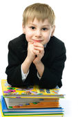 Little schoolboy with books — Stock Photo
