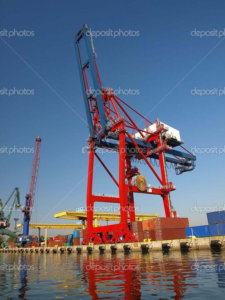 Large red container crane at an industrial harbor in Gdansk, Poland. — Stock Photo #1946317