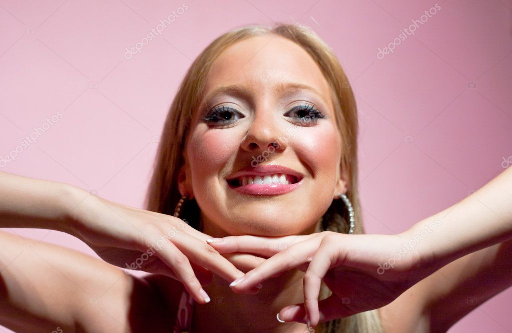 Blond girl smiling and posing with pink background — Stock Photo #1688487