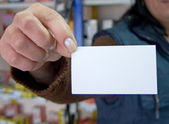 Woman holding blank visit card — Stock Photo