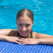 Wet blond girl in swimming pool — Stock Photo #1902845