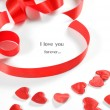 Love background. Small hearts and ribbon - Stock Photo
