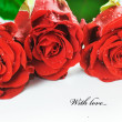 Red fresh roses on white — Stok fotoğraf