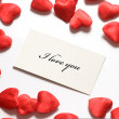 Love message and little hearts around - Stock Photo