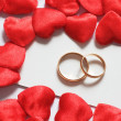 Stock Photo: Wedding rings in hearts environment