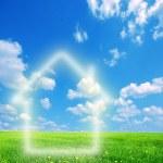 Dom wyobraźni na zielony ziemia — Zdjęcie stockowe