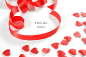 Love background. Small hearts and ribbon — Stock Photo