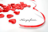 Love background. Small hearts and ribbon — Stok fotoğraf