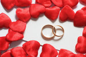 Wedding rings in hearts environment — Stock Photo