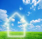 House imagination on green land — Stock Photo