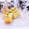 Gold Christmas gifts decoration — Stock Photo
