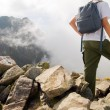 Active tourist in mountains — Stock Photo