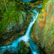 Waterfall in mountains - Stock fotografie