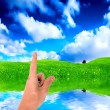 Pointing a finger at the sky - Stock Photo