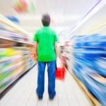 Customer in supermarket — Stock Photo
