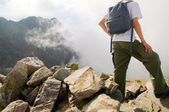 Active tourist in mountains — Stock Photo